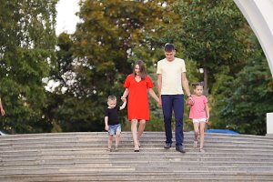 Young family of four: dad, mom