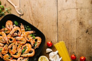 Roasted grilled shrimps on pan on wo