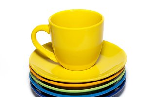 Yellow teacup and stack of saucers