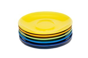 Stack of colored ceramic saucer