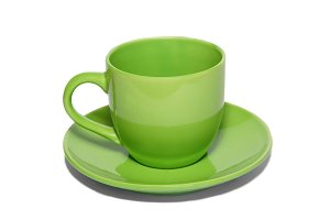 Green ceramic cup and saucer