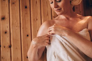 Woman putting on a towel after bath