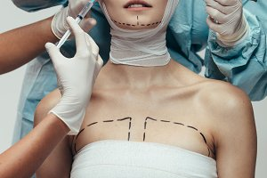 Woman undergoing a cosmetic surgery