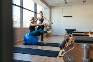 Women practicing pilates workout