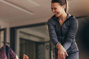 Smiling pilates trainer training
