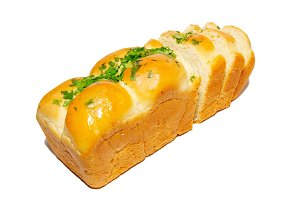 Golden fresh bread with greens