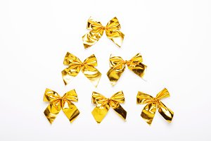 Golden bows on a white background