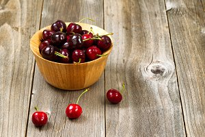 Seasonal Cherries on Rustic Wood