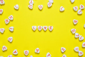 Word love on yellow background
