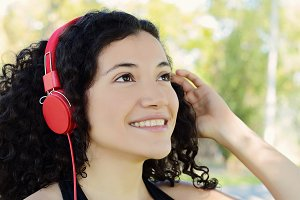 Young latin woman with headphones in