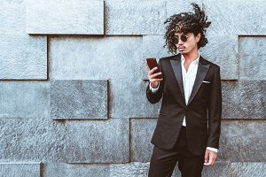 Young Asian businessman with phone
