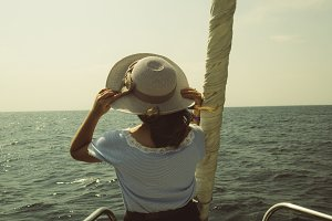 girl with hat on a yacht on the sea