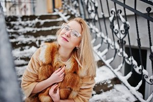 Portraiy of blonde girl in glasses,