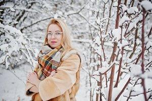 Portraiy of blonde girl in glasses,