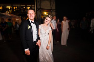 Stylish wedding couple at night agai
