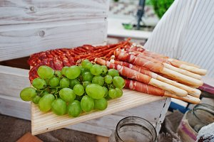 Green grapes and sticks with ham on