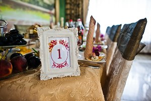 Frame with number one at table of gu
