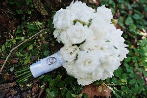 White wedding bouquet on wood near t