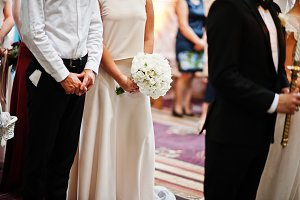 Hands of bridesmaids with bouquets a