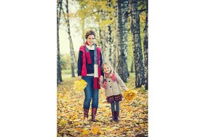 Mother and daughter in the autumn