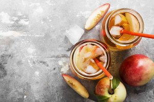 Peach ice tea on a gray background