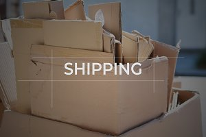 """Cardboard boxes with focus on """"shipp"""