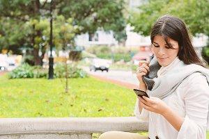 Young latin women sending message wi