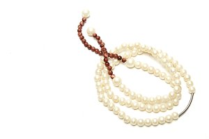 NATURAL PEARL NECKLACE ON WHITE