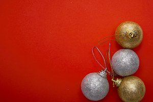 Christmas balls on red papar