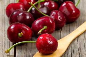 Ripe Cherries on Rustic Wood