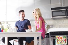 couple at home eating breakfast