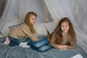 Two sisters are waiting for Xmas