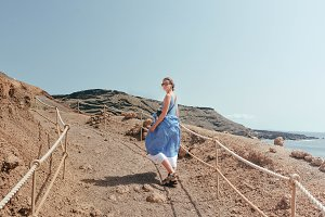 Happy Girl goes to Mountain near Sea