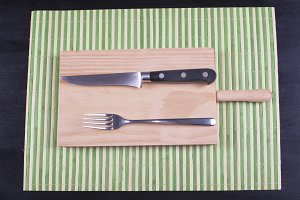 Fork and knife on wood