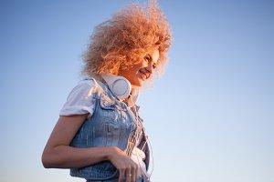 Trendy girl with large headphones