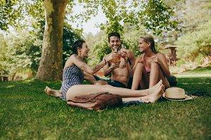 Friends toasting beer