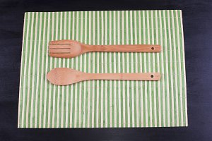 Wooden fork and spoon on wood