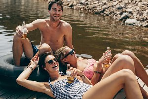 Friends enjoying holiday at a lake