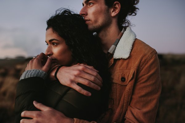 People Stock Photos: Jacob Lund - Romantic couple looking landscape