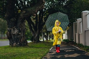 Little girl in raincoat walking