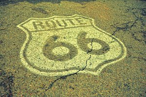 Old Route 66 sign on the asphalt.