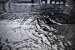 Water on street in rainy day