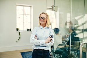 Young businesswoman smiling while st