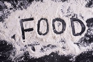 Word food written on meal flour