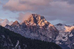 Mystical, dark sunrise in mountains