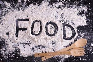Word food written on meal flour