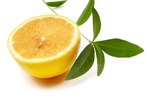 lemon with green leaf
