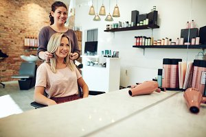 Smiling woman looking at her stylist