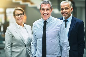 Smiling mature businessman standing