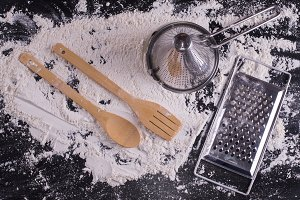 kitchen utensils on wood covered in